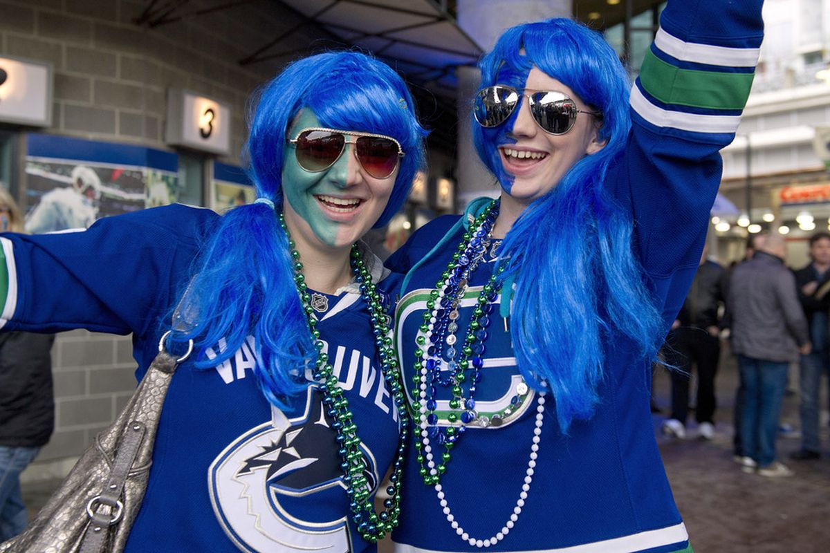 Two young Vancouver-based marketing professionals, I'm assuming, since apparently that's the only job anyone in that city has. (Photo by Rich Lam/Getty Images)