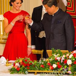 In a red Jenny Packham gown and princess crown (!!) for a  State Banquet hosted by Britain's Queen Elizabeth II on October 20th, 2015.