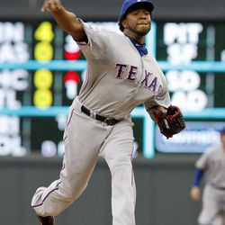 Texas Rangers starting pitcher Neftali Feliz throws against the Minnesota Twins during the first inning of a baseball game on Sunday, April 15, 2012, in Minneapolis. The players were all wearing  No. 42 in honor of Jackie Robinson Day.