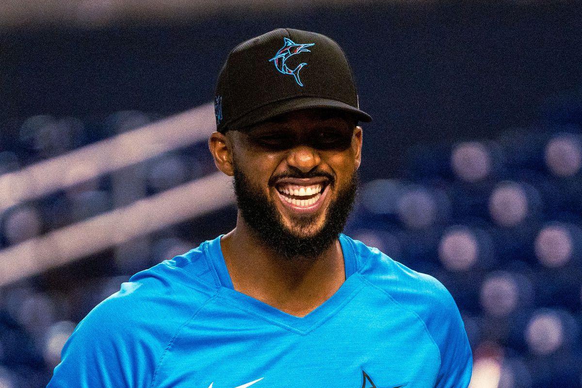 Sandy Alcantara laughs during Marlins batting practice at LoanDepot Park