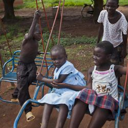 In this photo taken Friday, April 27, 2012, children play at the Bobi Health Centre which is housed in the grounds of a former camp for displaced persons who have now returned to their villages, in Bobi, near Gulu, Uganda. Some locals in Gulu have other concerns that complicate the military mission of forces now hunting for Lord's Resistance Army (LRA) leader Joseph Kony, such as the fear of reprisal attacks if they are thought to be helping the authorities find him, or concerns that troops hunting him will not be able to distinguish between the regular LRA fighters and their abducted children.