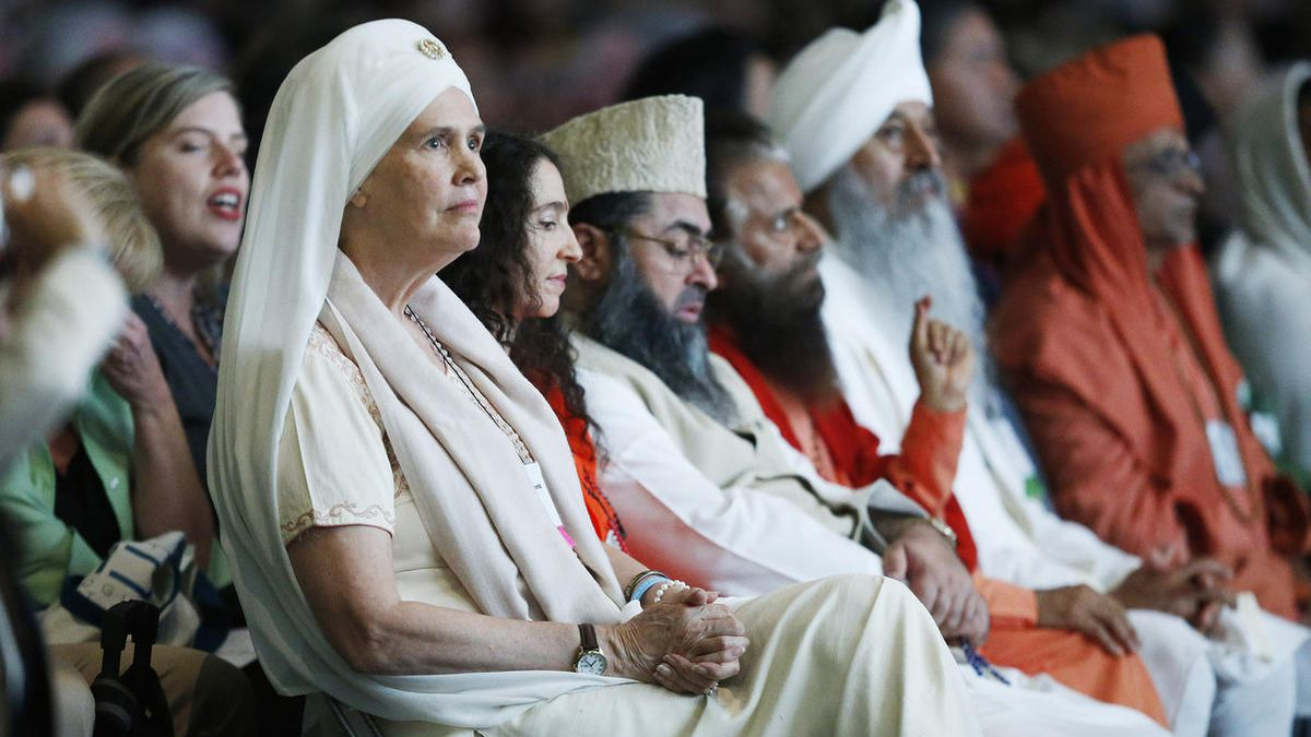 Parliament of the World's Religions attendees listen during talks by religious and local leaders in Salt Lake City Thursday, Oct. 15, 2015.