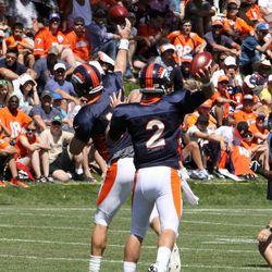Broncos quarterbacks Peyton Manning (front) and Zac Dysert throw passes at training camp