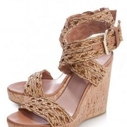 """Nothing screams summer like a pair of woven wedges out by the pool. Stuart Weitzman Woven Criss Cross Ankle Wedges, $385 at <a href=""""http://www.scoopnyc.com/shoes-and-handbags/shoes/heels/woven-criss-cross-ankle-wedges"""">Scoop NYC</a>."""