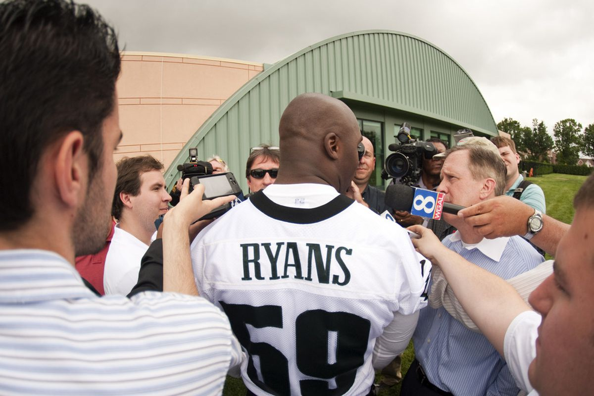 May 22, 2012; Philadelphia, PA, USA; Philadelphia Eagles linebacker DeMeco Ryans (59) is interviewed after practice during organized team activities at the Philadelphia Eagles NovaCare Complex. Mandatory Credit: Howard Smith-US PRESSWIRE