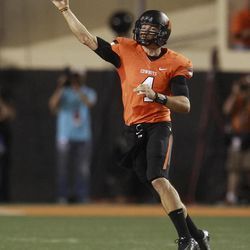 Oklahoma State quarterback J.W. Walsh passes against Texas in the first quarter of an NCAA college football game in Stillwater, Okla., Saturday, Sept. 29, 2012.