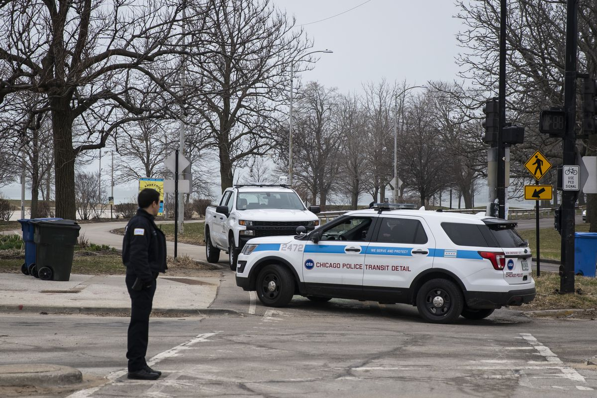 Chicago Police officers patrol the Lakefront Trail near North Avenue Beach Thursday morning as the city closes the area to pedestrians amid fears of the coronavirus pandemic.
