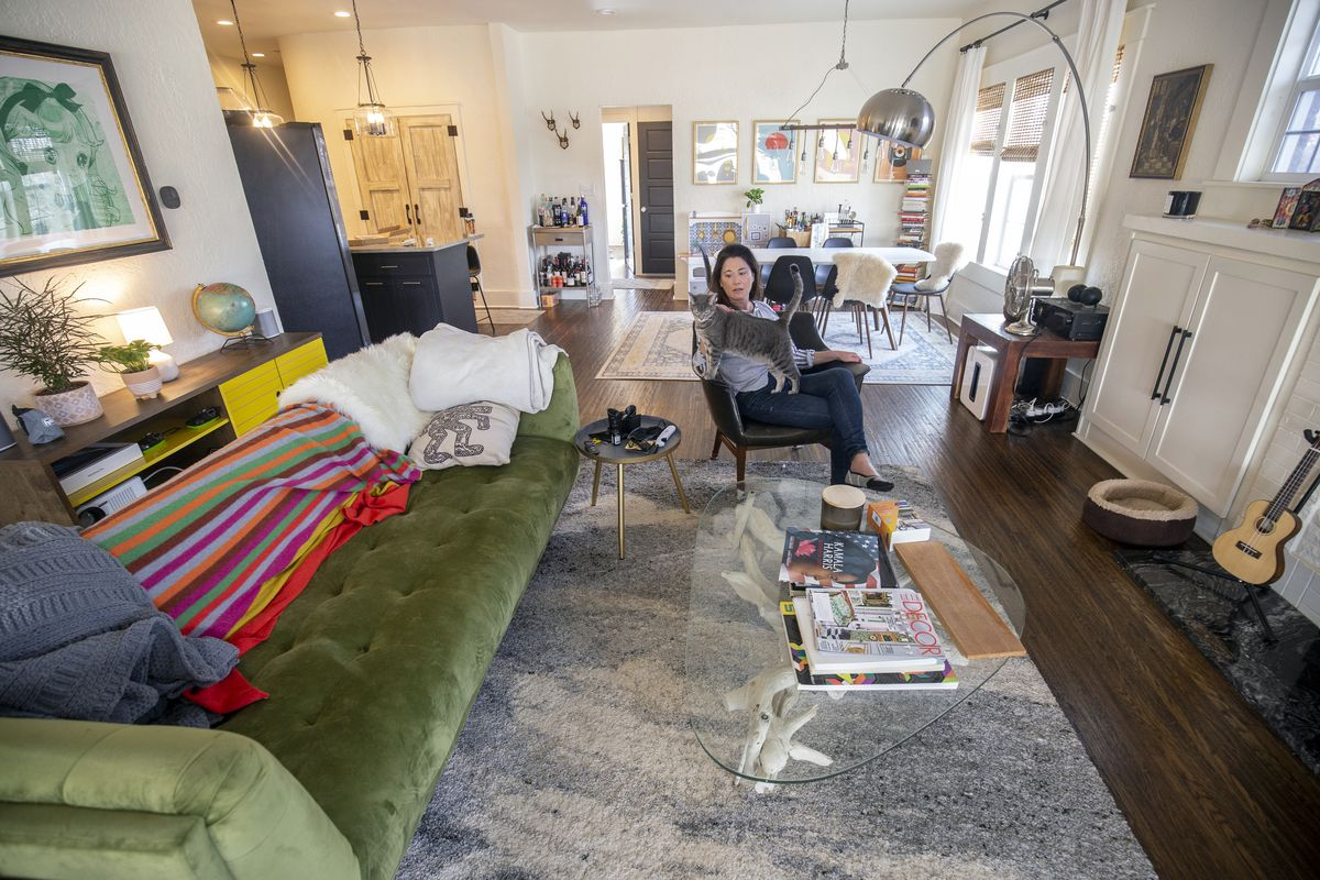 Stephanie Robesky sits with her cat Franny at her spacious home in the trendy Owen Park neighborhood just outside of downtown Tulsa, Okla., on Jan. 9, 2021. Robesky moved to Tulsa from the Bay Area as part of the George Kaiser Family Foundation's Tulsa Remote.