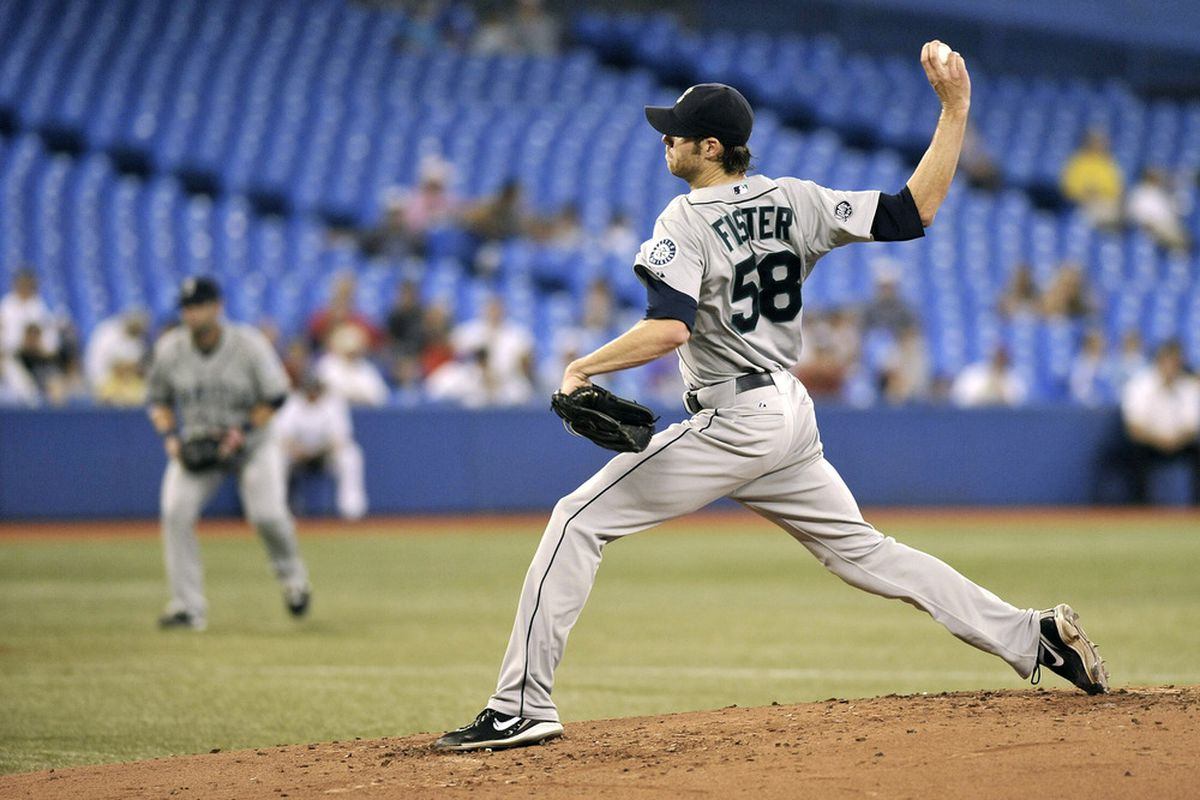 TORONTO, CANADA - JULY 21:  Doug Fister #58 of the Seattle Mariners delivers a pitch during MLB game action against the Toronto Blue Jays July 21, 2011 at Rogers Centre in Toronto, Ontario, Canada. (Photo by Brad White/Getty Images)