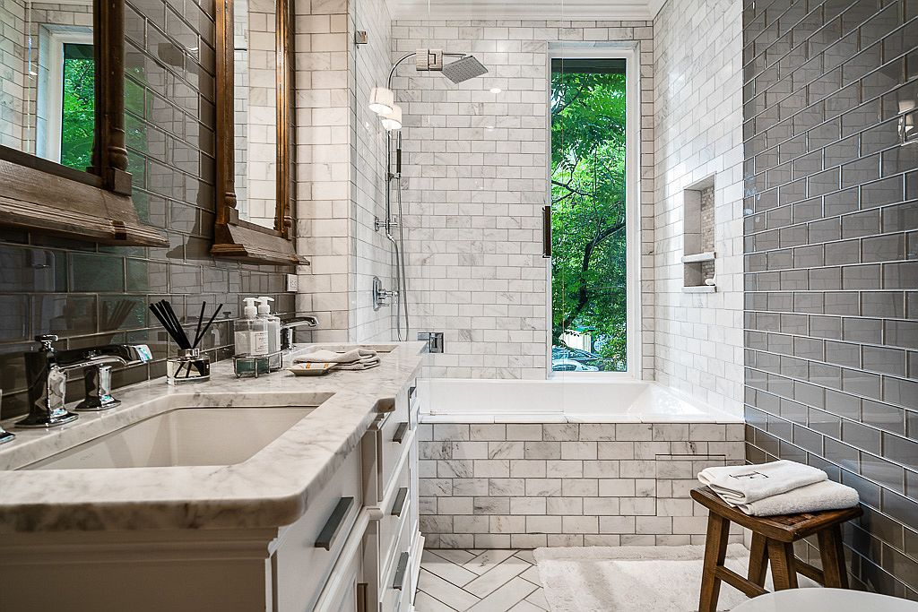 A guest bathroom done up in white and gray.