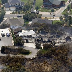 A burned home can be seen in the wake of a wildfire at the mouth of Weber Canyon on Tuesday, Sept. 5, 2017.