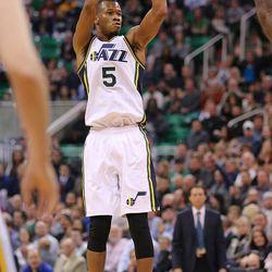 Utah Jazz guard Rodney Hood (5) shoots a 3-pointer as the Houston Rockets defeated the Utah Jazz 93-91 in NBA basketball Monday, Jan. 4, 2016, in Salt Lake City.