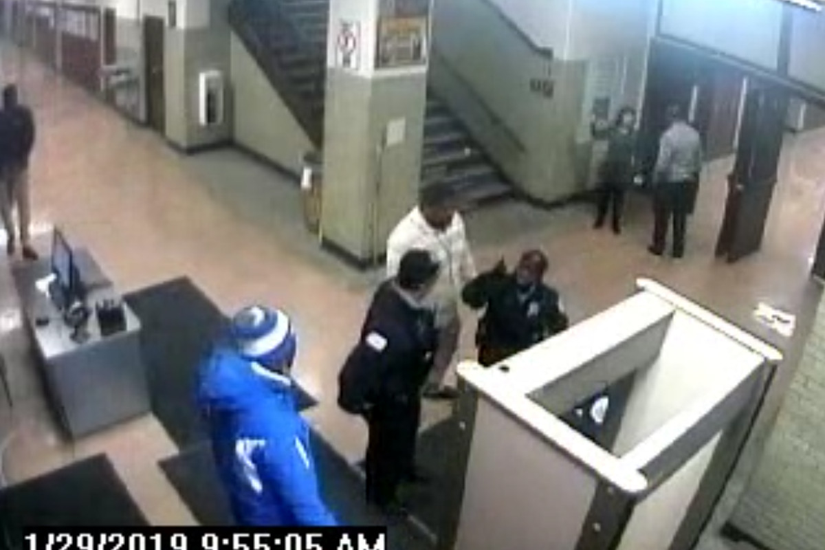 """Chicago Police Department Officer Sherri Tripp points at student Dignma Howard's father, Laurentio Howard, and screams """"Your daughter is going to jail."""""""