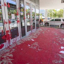 The front walk and other areas of the Salt Lake County District Attorney's Office building in Salt Lake City is covered in red paint on Friday, July 10, 2020. The building suffered tens of thousands of dollars in damage when protesters broke out at least three windows and spread red paint over large portions of the building and area in front of the structure on Thursday.