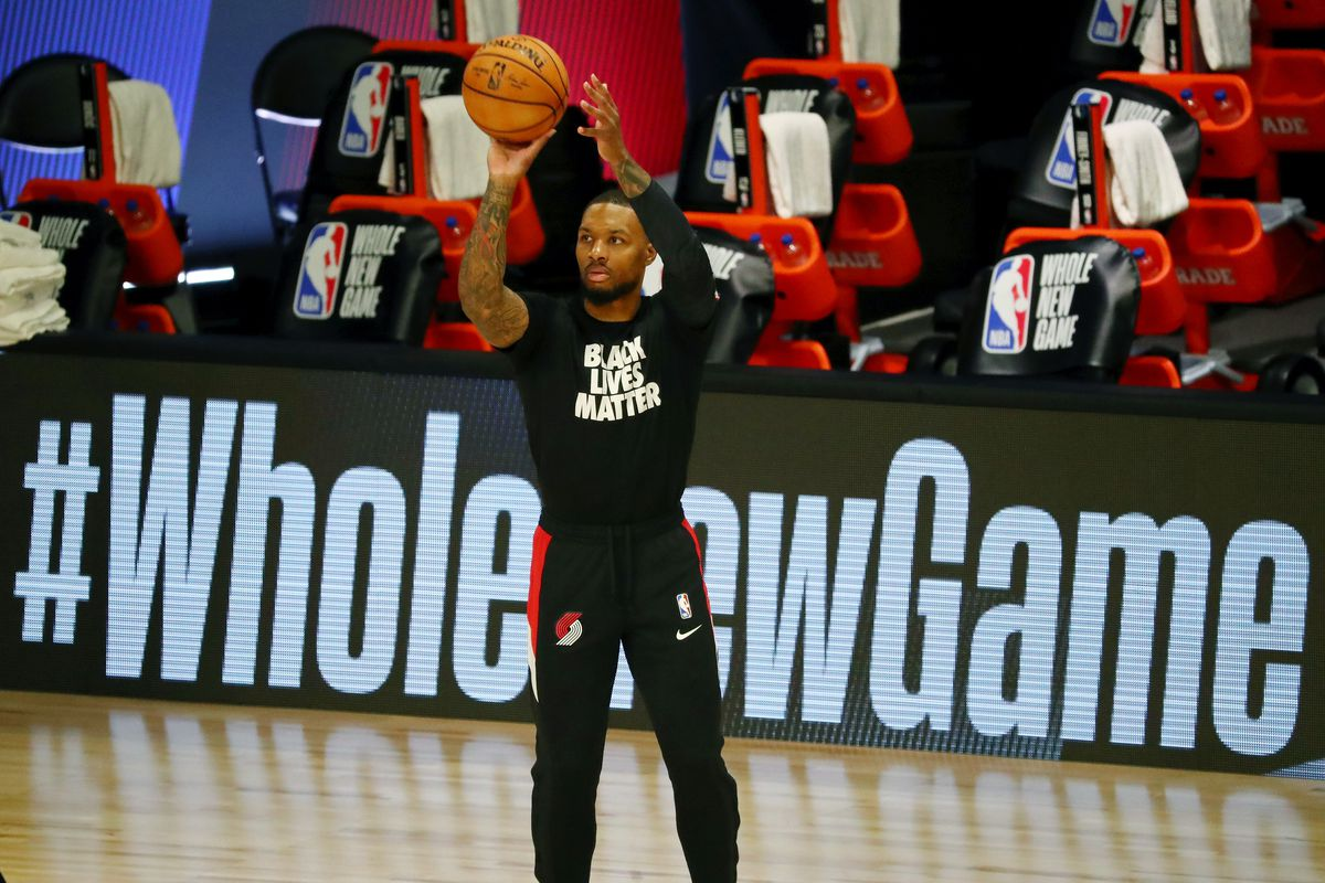 Damian Lillard of the Portland Trail Blazers warms up before a game against the Dallas Mavericks at The Field House at ESPN Wide World Of Sports Complex on August 11, 2020 in Lake Buena Vista, Florida.