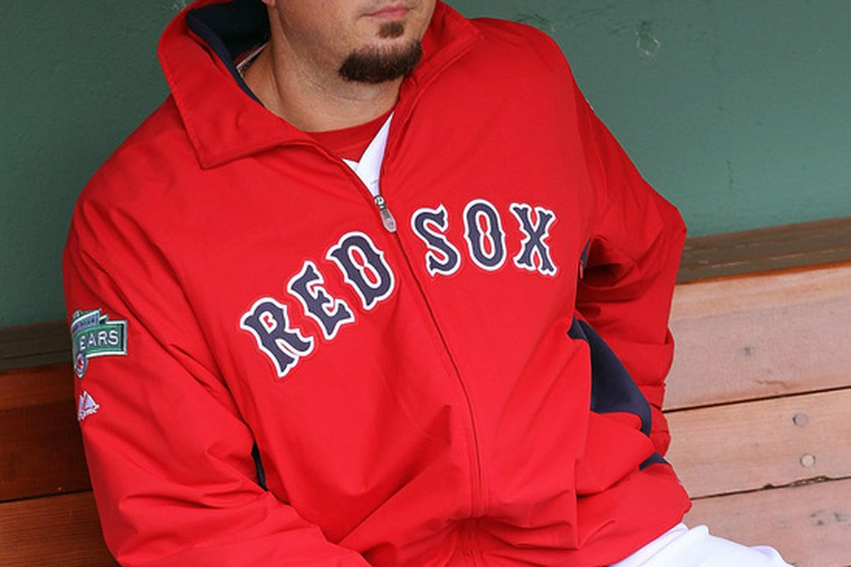 Josh Beckett of the Boston Red Sox sits in the dugout before facing the Cleveland Indians at Fenway Park May 10, 2012. (Photo by Jim Rogash/Getty Images)