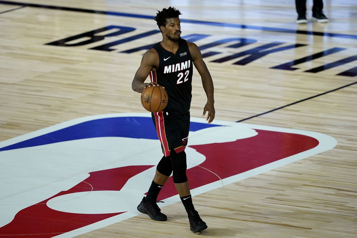 Jimmy Butler of the Miami Heat brings the ball up against the Toronto Raptors in the second half at HP Field House at ESPN Wide World Of Sports Complex on August 3, 2020 in Lake Buena Vista, Florida.