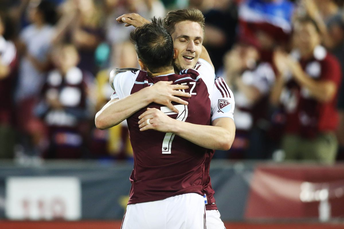Kevin Doyle and Vicente Sanchez, two of Colorado's most troublesome attackers, celebrate a goal