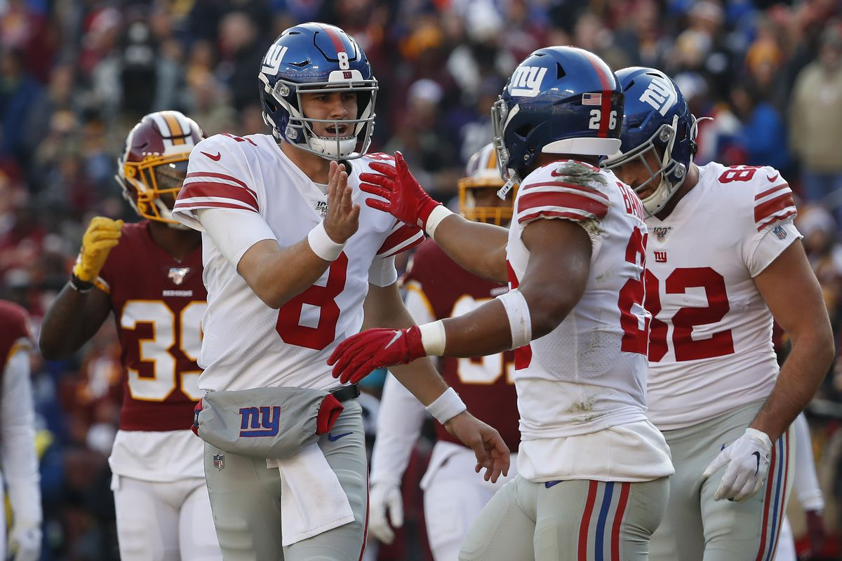 New York Giants quarterback Daniel Jones celebrates with Giants running back Saquon Barkley after connecting on a touchdown pass against the Washington Redskins in the second quarter at FedExField.