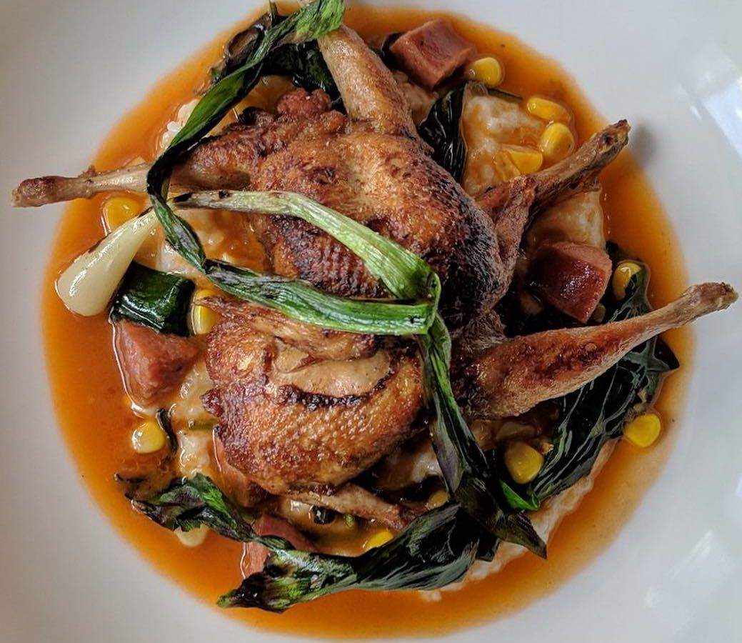 Pan roasted quail with rice grits, andouille, corn, black trumpet mushrooms, and ramps from Spring in Marietta