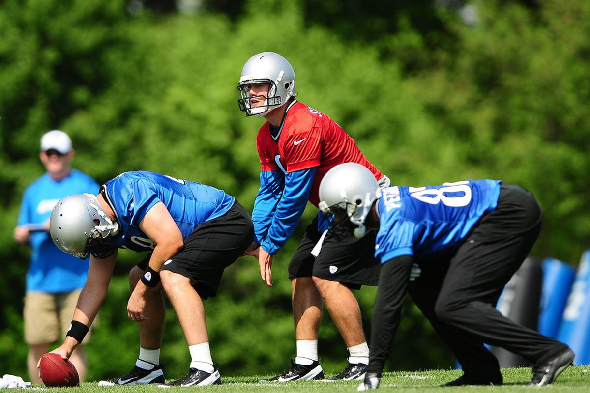 May 21, 2012; Allen Park, MI, USA; Detroit Lions quarterback Matthew Stafford (9) takes a snap from center during organized team activities at Detroit Lions training facility. Mandatory Credit: Andrew Weber-US PRESSWIRE