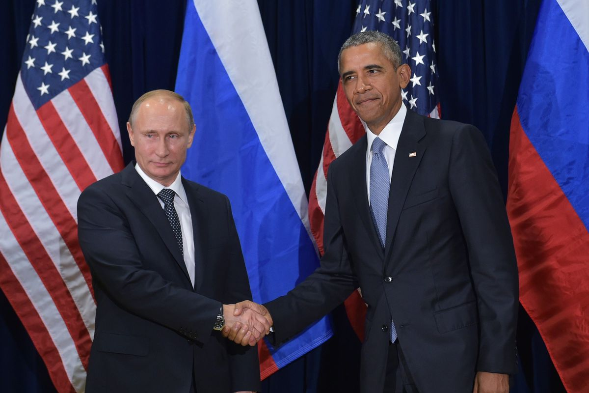 Russian President Vladimir Putin and former U.S. President Barack Obama shake hands