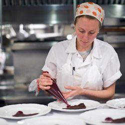 Christina Tosi, plating her space food dessert.