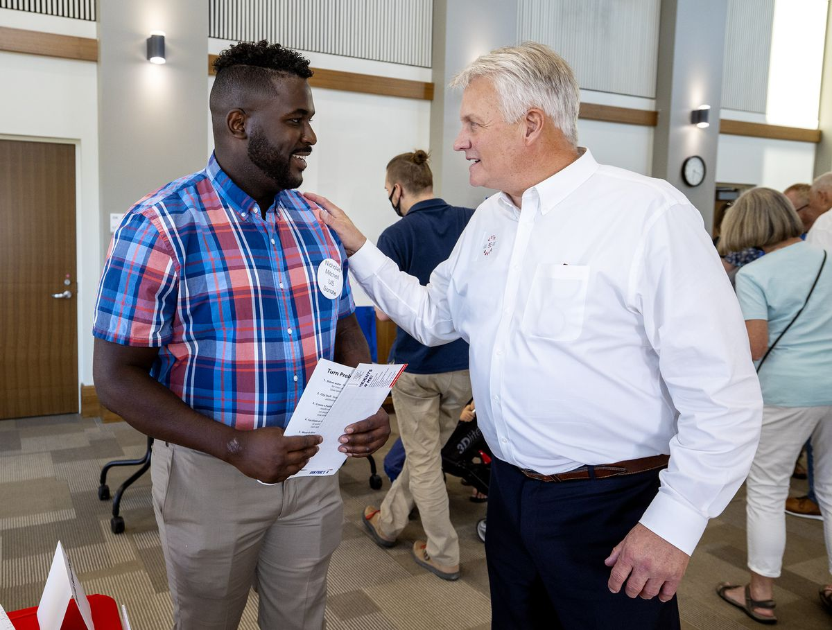 Nick Mitchell, a U.S. Senate candidate, left, talks with Cottonwood Heights City Council candidate David Rawlings, at a meet-the-candidates meeting in Cottonwood Heights on Tuesday, Sept. 14, 2021.