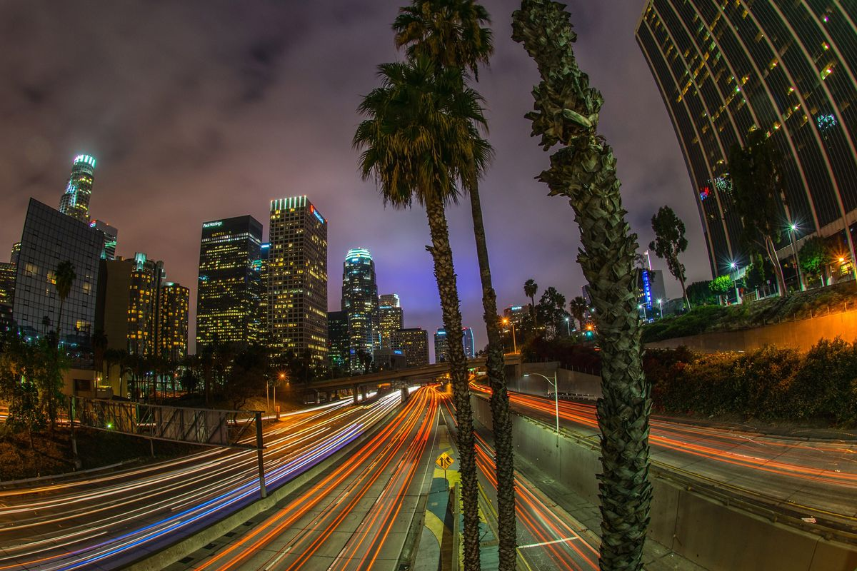 Sunday traffic moves on Interstate Highway 110 at dusk through downtown of Los Angeles on March 23, 2014.