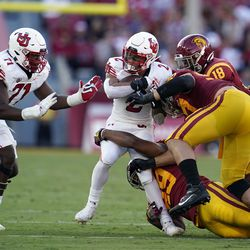 Utah running back Micah Bernard (2) is brought down by a group of Southern California defenders during the first half of an NCAA college football game Saturday, Oct. 9, 2021, in Los Angeles.