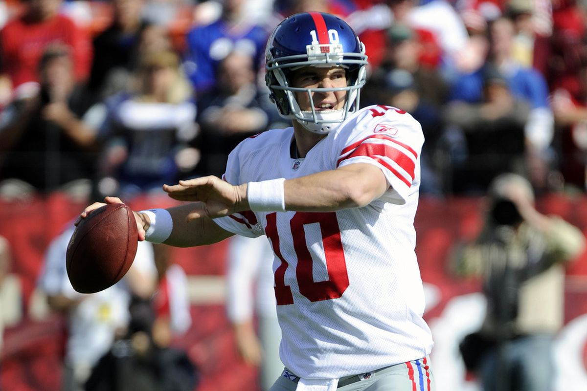 Eli Manning of the New York Giants throw a pass against the San Francisco 49ers during an NFL football game at Candlestick Park November 13, 2011 in San Francisco, California. The 49ers won the game 27-20. (Photo by Thearon W. Henderson/Getty Images)