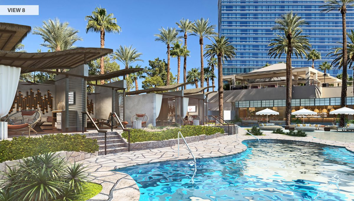 A pool scene with cabanas in the background