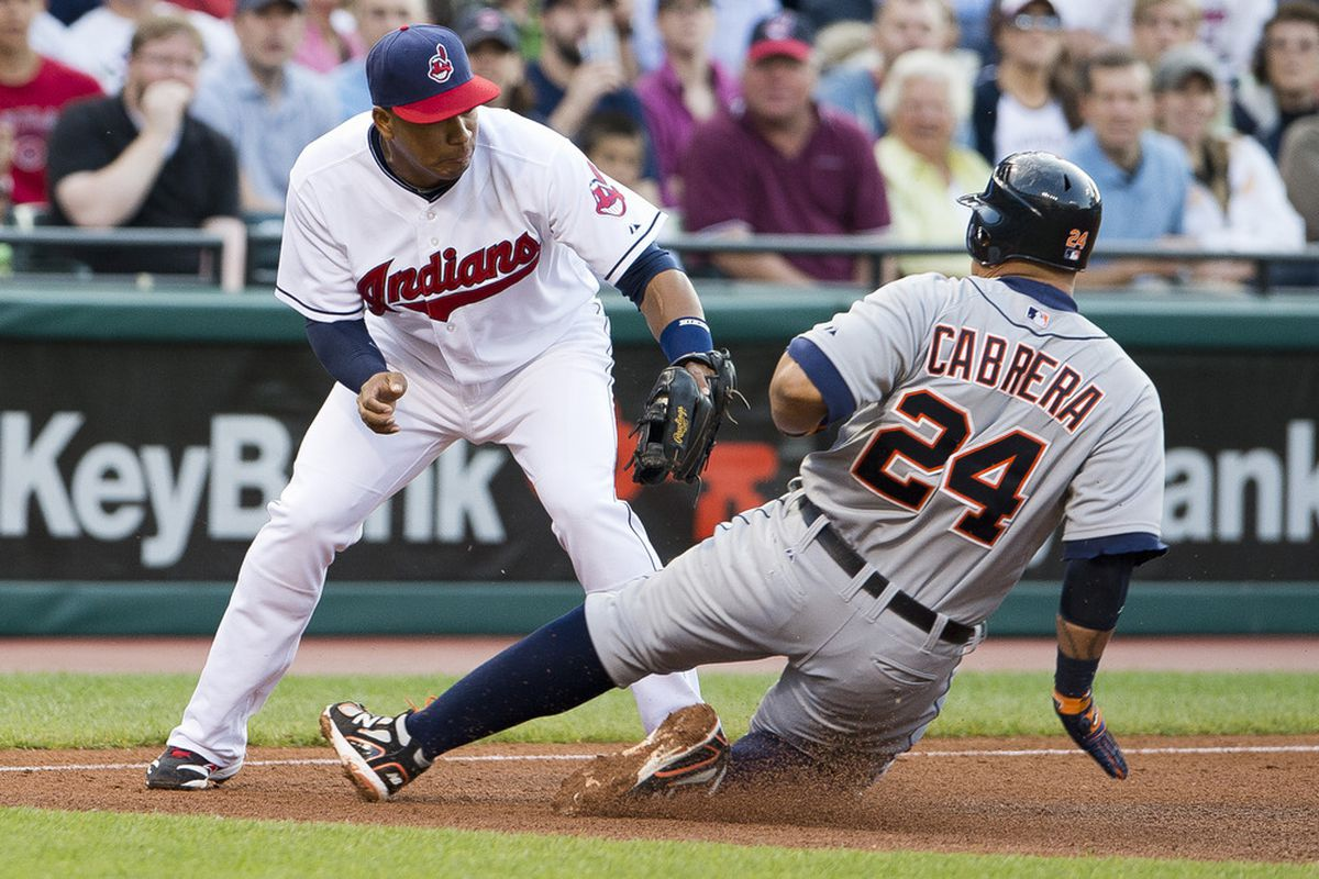 CLEVELAND, OH - MAY 23: Third baseman Jose Lopez #4 of the Cleveland Indians tags out Miguel Cabrera #24 of the Detroit Tigers during the third inning at Progressive Field on May 23, 2012 in Cleveland, Ohio. (Photo by Jason Miller/Getty Images)