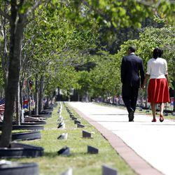 President Barack Obama and first lady Michelle Obama visit Warriors Walk at Fort Stewart, Ga., Friday.
