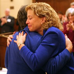 Democratic National Committee Chairwoman Debbie Wasserman Schultz, right, hugs Vice-Chairwoman Linda Chavez-Thompson during the DNC's Executive Committee meeting at the Montage Deer Valley in Park City on Saturday, Dec. 1, 2012.
