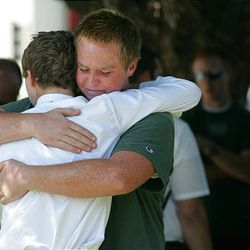 Stephen Henriksen, right, gets a hug from fellow church member Ryan Henshaw after a shooting that killed Bishop Clay Sannar of the Church of Jesus Christ of Latter-Day Saints Sunday, Aug. 29, 2010 in Visalia, Calif.