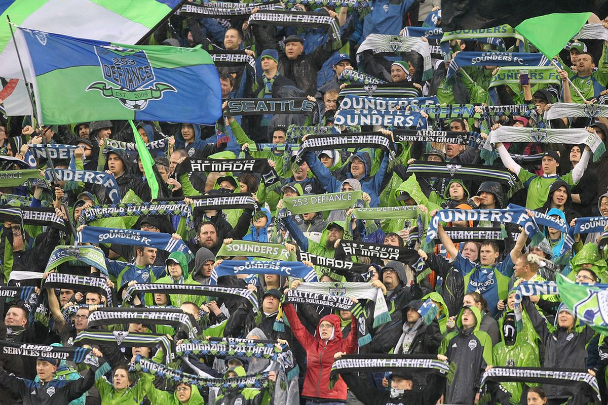 SEATTLE - MAY 14:  Fans of the Seattle Sounders FC cheer during the game against the Portland Timbers at Qwest Field on May 14, 2011 in Seattle, Washington. The Sounders and Timbers played to a 1-1 tie. (Photo by Otto Greule Jr/Getty Images)