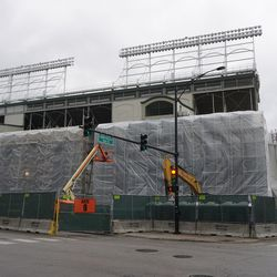 Tarps covering the exterior of the ballpark, at the Addison and Sheffield corner