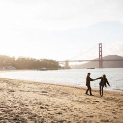 """The total triple threat for SF engagement shoot locations is <strong>Crissy Field</strong>. There's the Golden Gate Bridge, the beach, and 360 degree views. [Photo from <a href=""""http://ryonlockhart.com/"""">Ryon:Lockhart Photography</a>]"""