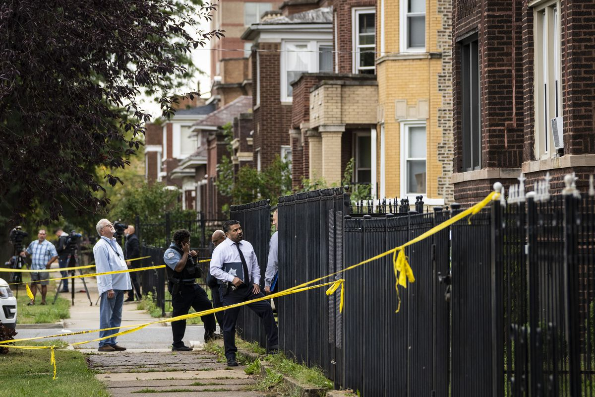 Chicago Police investigate inside an apartment in the 7700 block of South Carpenter Street after an officer shot and killed a man while answering a call of a domestic disturbance in the Gresham building on the South Side, Monday morning, Oct. 4, 2021.