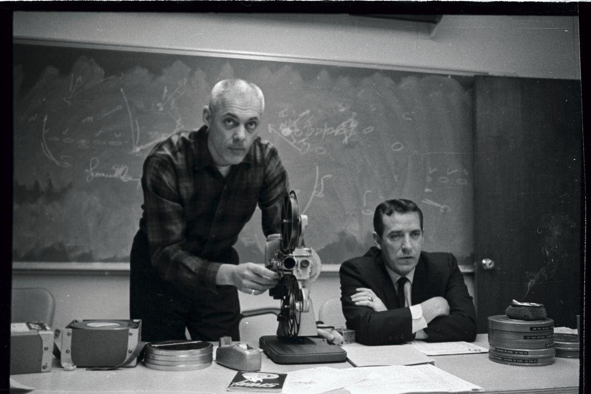Coach Adjusting Film Projector