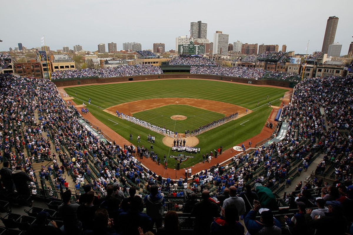 CHICAGO - APRIL 12: Members of the Chicago Cubs and the Milwaukee Brewers appear on the field for player introductions on Opening Day at Wrigley Field on April 12, 2010 in Chicago, Illinois. (Photo by Jonathan Daniel/Getty Images)