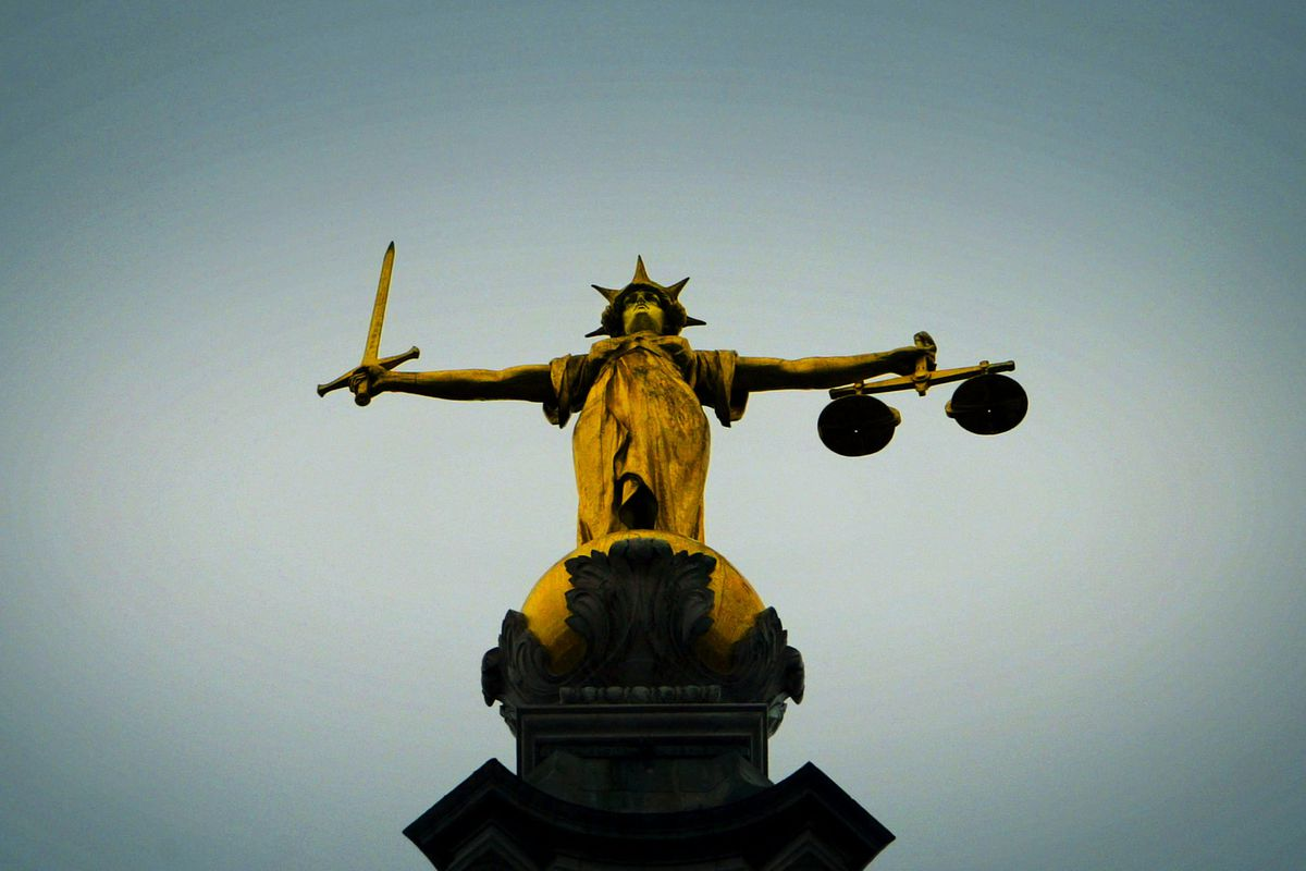 A statue of the scales of justice in London.