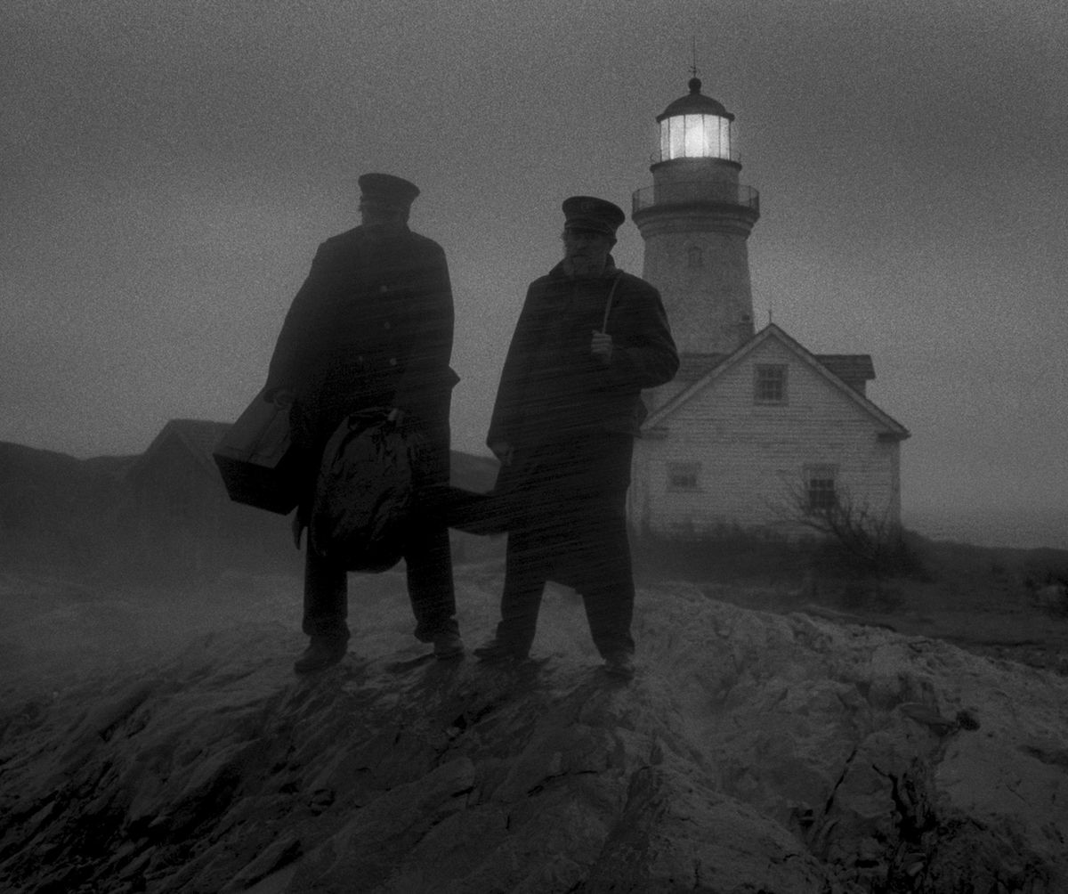 The two wickies stand on the shore, waiting in the middle of dense rain and fog.