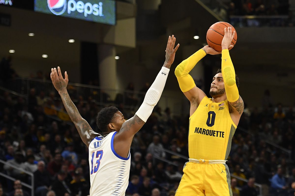 Markus Howard of the Marquette Golden Eagles shoots in the first half Darious Hall #13 of the DePaul Blue Demons at Wintrust Arena on March 03, 2020 in Chicago, Illinois.