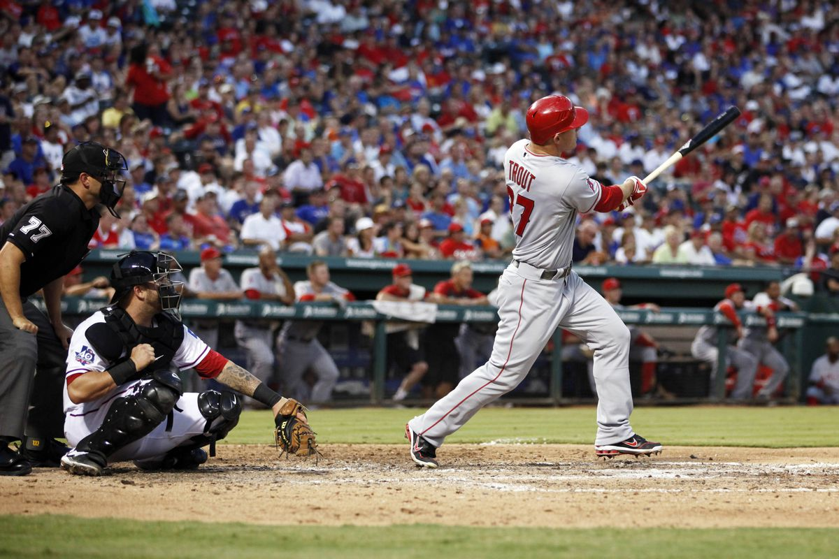 Jul 31, 2012; Arlington, TX, USA; Los Angeles Angels center fielder Mike Trout (27) hits a home run during the sixth inning of the game against the Texas Rangers at Rangers Ballpark. Mandatory Credit: Tim Heitman-US PRESSWIRE