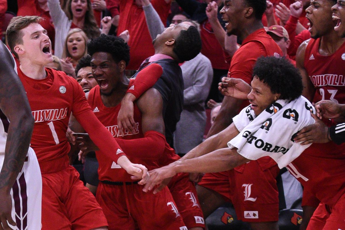 The team celebrates after Keith Oddo hits a three in the win over Virginia Tech.
