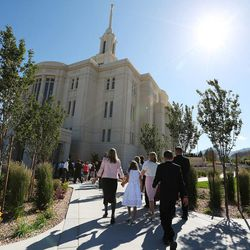 Attendees enter the Payson Utah Temple for  the  dedication in Payson  Sunday, June 7, 2015.
