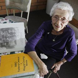 In this March 30, 2012, photo, Verla Morris, who will turn 100 later this year, poses for a photograph as she goes through some of her family census data from the 19th and 20th centuries at her local residential senior center in Chandler, Ariz. When the 1940 census records are released Monday, April 2, Morris will see her own name and details about her life in the records being released after 72 years of confidentiality expires, allowing her to find out more about her family tree.