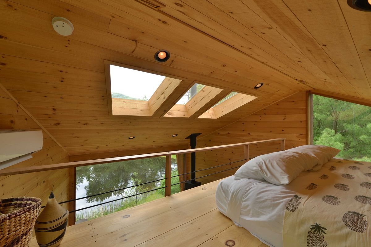 Lofted bed overlooking living room